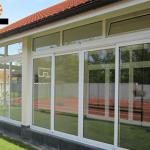 Alumil klizni sistem za zastakljivanje terasa zatvorena vrata